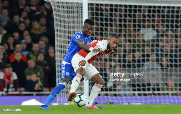Daniel Amartey of Leicester City in action with Alexandre Lacazette of Arsenal during the Premier League match between Arsenal FC and Leicester City...