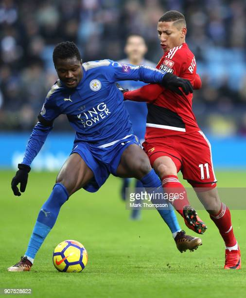 Daniel Amartey of Leicester City is challenged by Richarlison de Andrade of Watford during the Premier League match between Leicester City and...