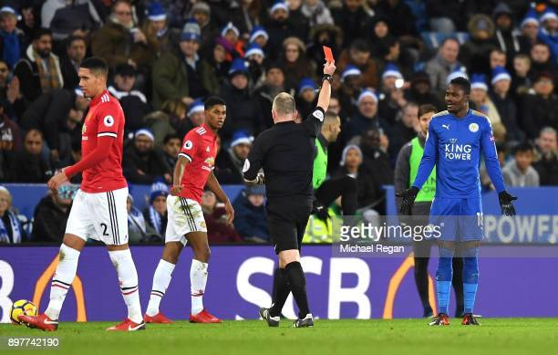 Daniel Amartey of Leicester City is shown the red card by referee Jonathan Moss during the Premier League match between Leicester City and Manchester...