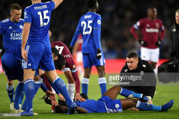 Daniel Amartey of Leicester City receives medical treatment during the Premier League match between Leicester City and West Ham United at The King...