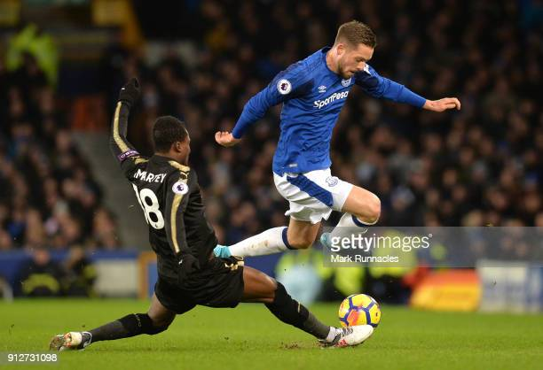 Daniel Amartey of Leicester City tackles Gylfi Sigurdsson of Everton during the Premier League match between Everton and Leicester City at Goodison...