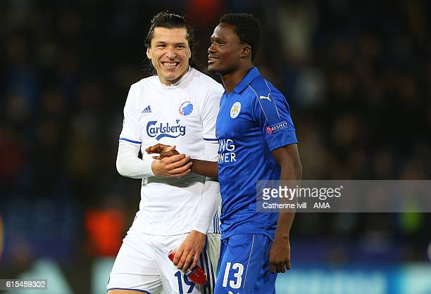 Daniel Amartey of Leicester City with former team mate Federico Santander of FC Copenhagen the UEFA Champions League match between Leicester City FC...
