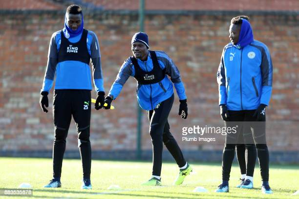 Daniel Amartey shares a joke with Wilfred Ndidi during the Leicester City training session at Belvoir Drive Training Complex on December 01 2017 in...