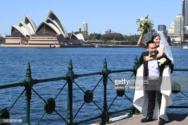 Daniel and Ella Kim pose for photos after their wedding held at Olympic Park in the suburb of Milsons Point on September 03, 2021 in Sydney,...