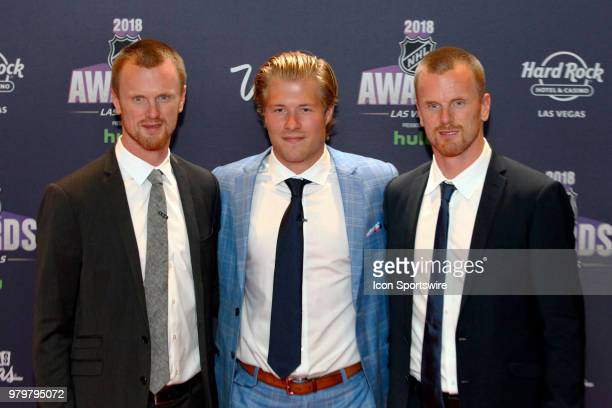 Daniel and Henrik Sedin of the Vancouver Canucks pose on the red carpet with teammate Brock Boeser during the 2018 NHL Awards presented by Hulu at...