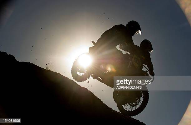 Daniel and Joe Millard jump over the crest of a dune on their Husaberg 650 sidecar during the main quad and sidecar race during the 2012 RHL Weston...
