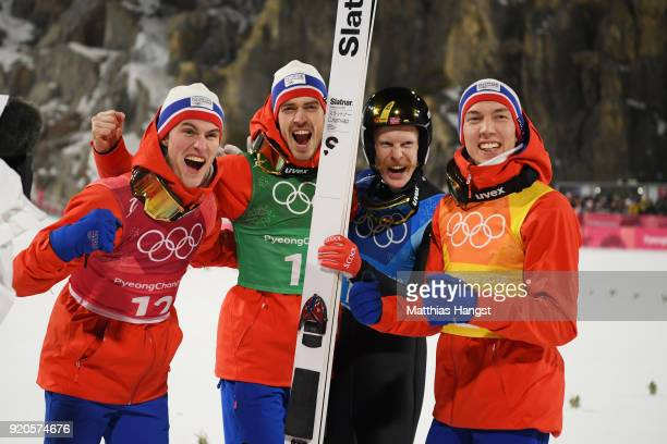 Daniel Andre Tande Andreas Stjernen Johann Andre Forfang and Robert Johansson of Norway celebrate winning gold in the Ski Jumping Men's Team Large...