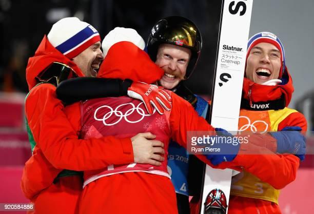 Daniel Andre Tande, Andreas Stjernen, Johann Andre Forfang and Robert Johansson of Norway celebrate winning gold in the Ski Jumping - Men's Team...