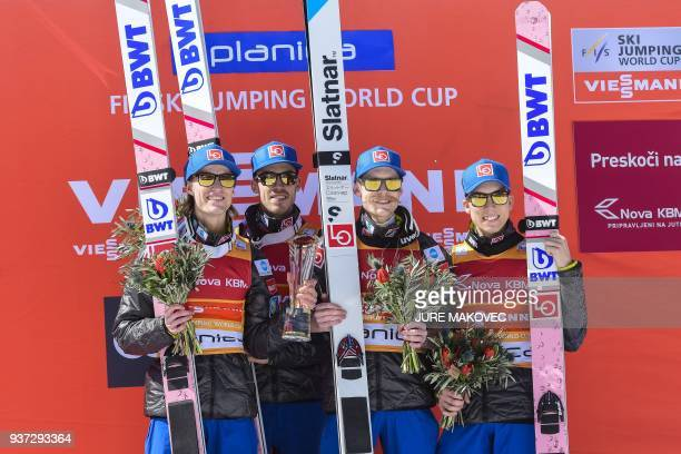 Daniel Andre Tande, Andreas Stjernen, Robert Johansson and Johann Andre Forfang of Norway pose on podium after they won the FIS Ski Jumping World Cup...