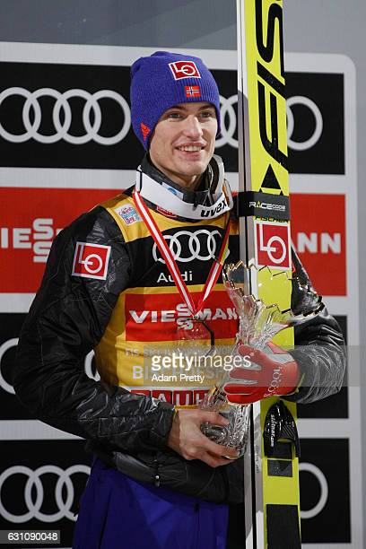 Daniel Andre Tande celebrates the 3rd place at the 65th Four Hills Tournament ski jumping event on Day 2 of the 65th Four Hills Tournament ski...
