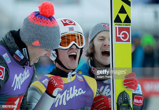 Daniel Andre Tande of Norway celebrates after his final competition jump on Day 2 of the 65th Four Hills Tournament ski jumping event on January 1...