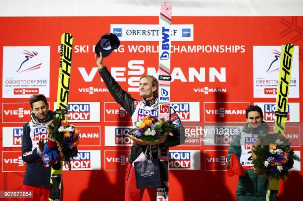 Daniel Andre Tande of Norway celebrates victory Kamil Stoch of Poland celebrates second and Richard Freitag of Germany celebrates third in the FIS...