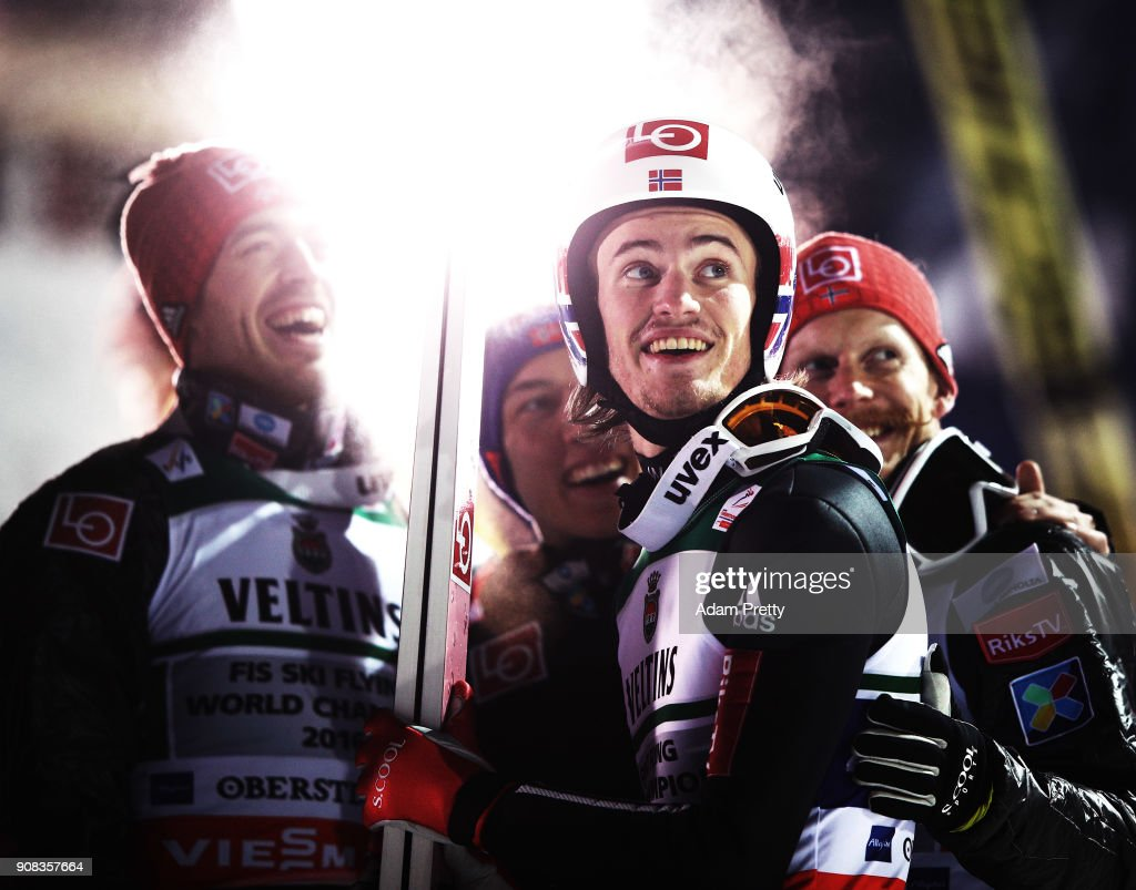 Daniel Andre Tande of Norway celebrates with team mates Robert Johansson, Andreas Stjernen and Johann Andre Forfang of Norway after winning the gold medal in the Flying Hill Team competition of the Ski Flying World Championships on January 21, 2018 in Oberstdorf, Germany.
