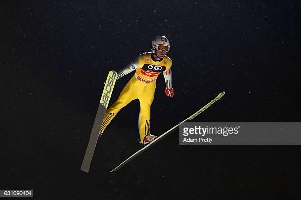 Daniel Andre Tande of Norway competes at the first round on Day 2 of the 65th Four Hills Tournament ski jumping event at PaulAusserleitnerSchanze on...