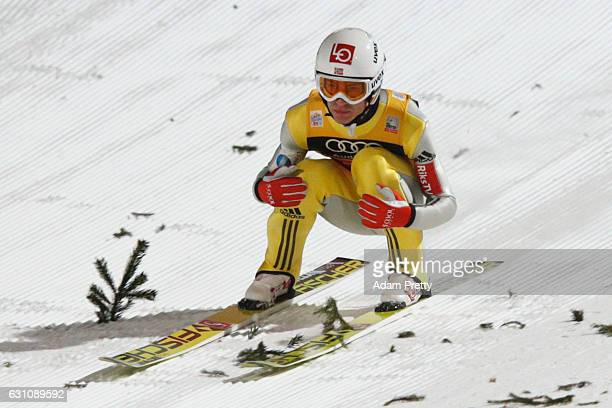 Daniel Andre Tande of Norway reacts at the final round on Day 2 of the 65th Four Hills Tournament ski jumping event at PaulAusserleitnerSchanze on...