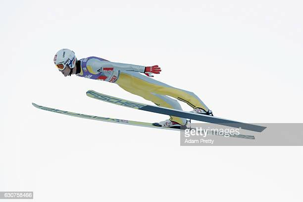 Daniel Andre Tande of Norway soars through the air during his first competition jump on Day 2 of the 65th Four Hills Tournament ski jumping event on...