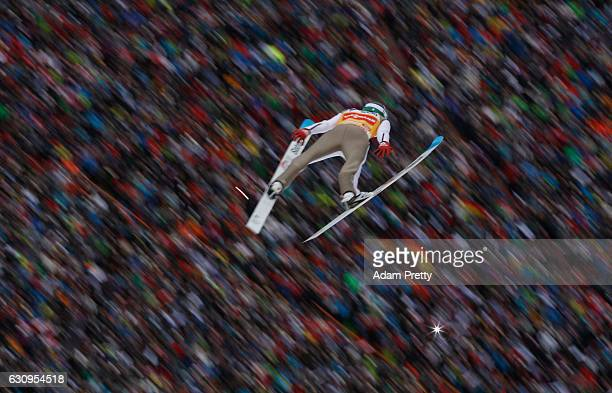 Daniel Andre Tande of Norway soars through the air during his first competition jump on Day 2 on January 4 2017 in Innsbruck Austria