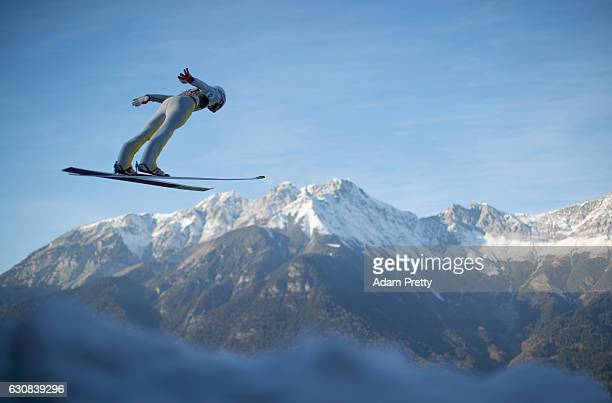 Daniel Andre Tande of Norway soars through the air during his qualification jump on Day 1 of the 65th Four Hills Tournament ski jumping event on...