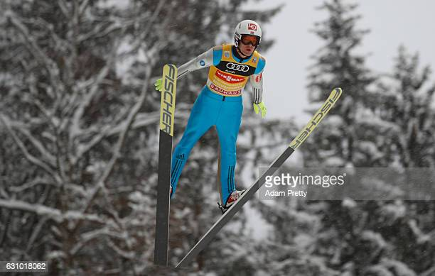 Daniel Andre Tande of Norway soars through the air during his training jump on Day 1 of the 65th Four Hills Tournament ski jumping event on January 5...