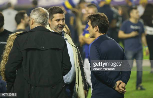 Daniel Angelici President of Boca Juniors talks to Guillermo Barros Schelotto coach of Boca Juniors during the celebration event after winning the...
