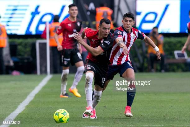 Daniel Arreola of Atlas fights for the ball with Alan Pulido of Chivas during the quarter finals second leg match between Chivas and Atlas as part of...