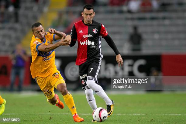 Daniel Arreola of Atlas fights for the ball with Rafael de Souza of Tigres during the 8th round match between Atlas and Tigres UANL as part of the...
