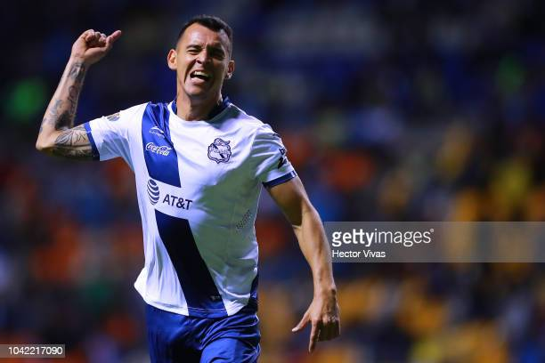 Daniel Arreola of Puebla celebrates after scoring the second goal of his team during the 10th round match between Puebla and America as part of the...