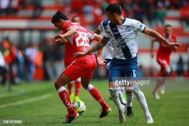 Daniel Arreola of Puebla struggles for the ball with Diego Abella of Toluca during the 2nd round match between Toluca and Puebla as part of the...