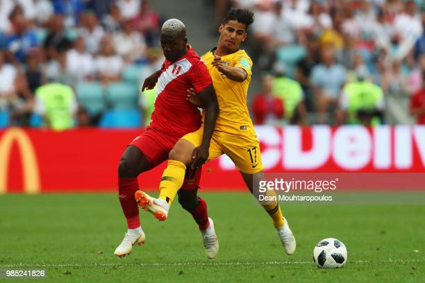 Daniel Arzani of Australia battles for the ball with Luis Advincula of Peru during the 2018 FIFA World Cup Russia group C match between Australia and...
