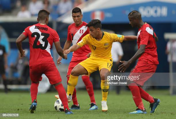 Daniel Arzani of Australia is challenged by Pedro Aquino of Peru Paolo Hurtado of Peru and Christian Ramos of Peru during the 2018 FIFA World Cup...