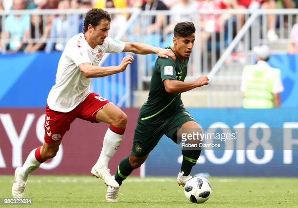 Daniel Arzani of Australia runs with the ball under pressure from Thomas Delaney of Denmark during the 2018 FIFA World Cup Russia group C match...