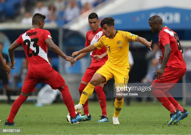 Daniel Arzani of Australia takes on Pedro Aquino of Peru during the 2018 FIFA World Cup Russia group C match between Australia and Peru at Fisht...