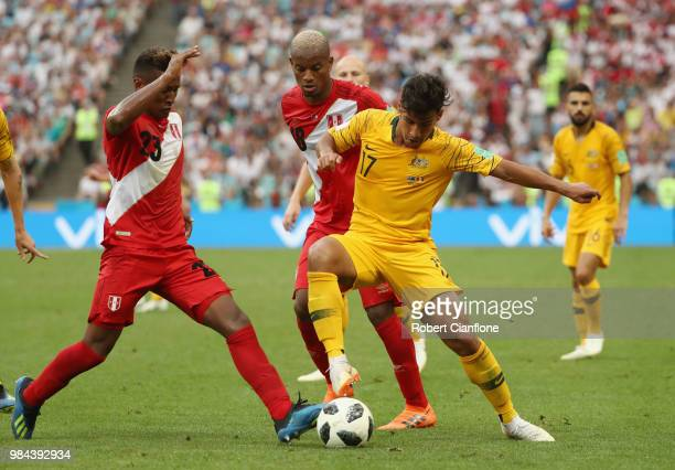 Daniel Arzani of Australia under pressure from Pedro Aquino and Andre Carrillo of Peru during the 2018 FIFA World Cup Russia group C match between...
