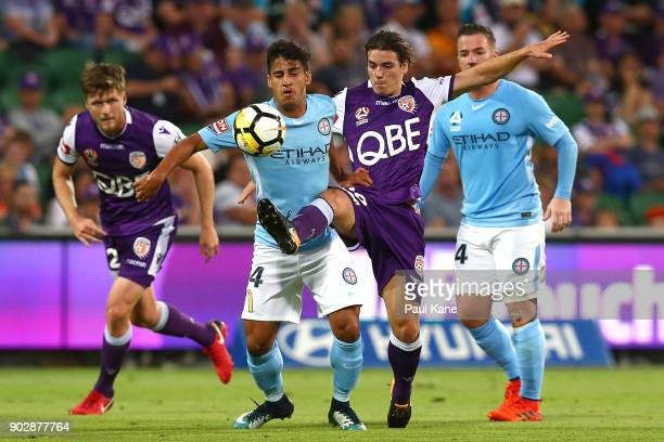 Daniel Arzani of Melbourne and Jeremy Walker of the Glory contest for the ball during the round 15 ALeague match between the Perth Glory and...