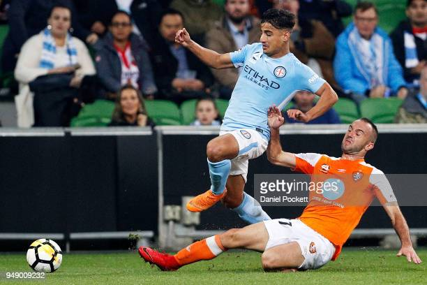 Daniel Arzani of Melbourne City and Ivan Franjic of Brisbane Roar contest the ball during the ALeague Elimination Final match between the Melbourne...