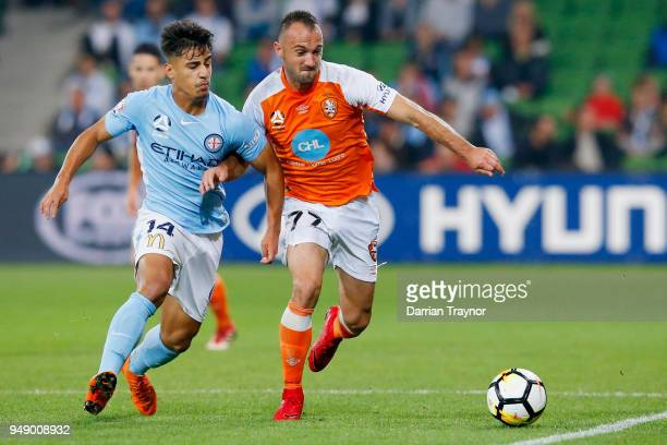 Daniel Arzani of Melbourne City and Ivan Franjic of the Roar compete during the ALeague Elimination Final match between the Melbourne City and the...