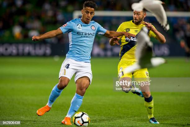 Daniel Arzani of Melbourne City and Joshua Rose of the Central Coast Mariners contest the ball during Round 26 of the Hyundai ALeague Series between...