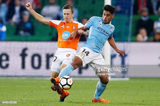 Daniel Arzani of Melbourne City and Matt McKay of Brisbane Roar contest the ball during the ALeague Elimination Final match between the Melbourne...