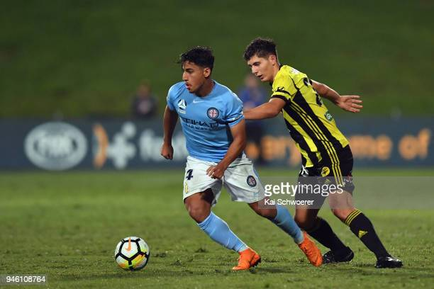 Daniel Arzani of Melbourne City controls the ball from Liberato Cacace of the Phoenix during the round 27 ALeague match between the Wellington...