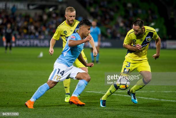 Daniel Arzani of Melbourne City controls the ball in front of Connor Pain of the Central Coast Mariners and Joshua Rose of the Central Coast Mariners...
