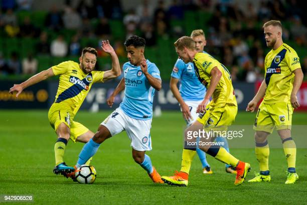 Daniel Arzani of Melbourne City controls the ball in front of Kye Rowles of the Central Coast Mariners Joshua Rose of the Central Coast Mariners and...