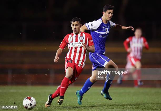 Daniel Arzani of Melbourne City is challenged by Dylan Blumberg of Hakoah during the FFA Cup round of 16 match between Hakoah Sydney City East and...