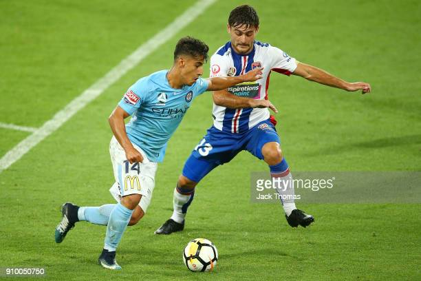 Daniel Arzani of Melbourne City Ivan Vujica of the Jets compete for the ball and during the round 18 ALeague match between Melbourne City FC and the...