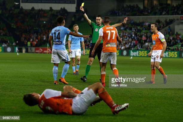 Daniel Arzani of Melbourne City recievers a yellow card from Jarred Gillett for a foul on Eric Bautheac of Brisbane Roar during the ALeague...