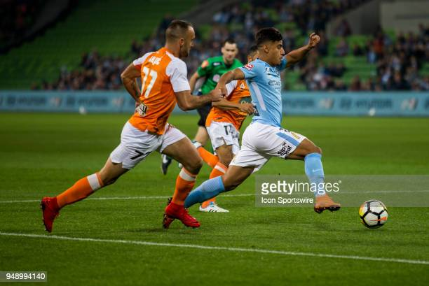 Daniel Arzani of Melbourne City runs with the ball with Ivan Franjic of the Brisbane Roar in pursuit during the Elimination Final of the Hyundai...