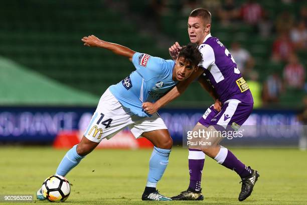 Daniel Arzani of Melbourne controls the ball against Walter Scott of the Glory during the round 15 ALeague match between the Perth Glory and...