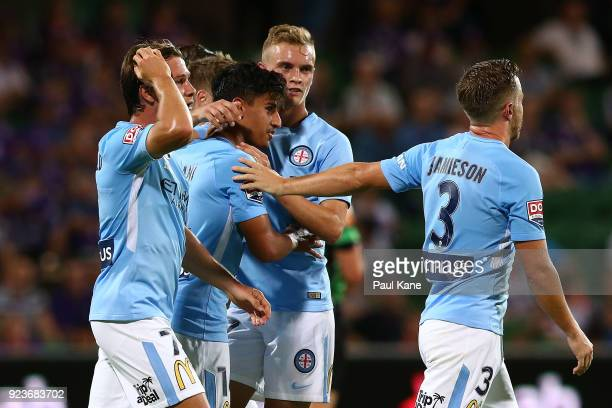 Daniel Arzani of Melbourne is congratulated by tream mates after scoring a goal during the round 21 ALeague match between the Perth Glory and...