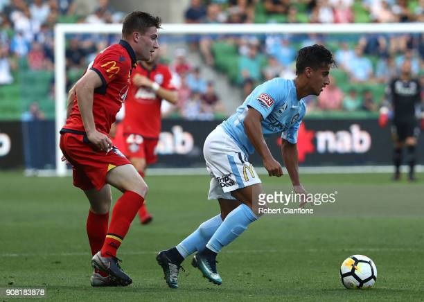 Daniel Arzani of the City is challenged by Ryan Strain of Adelaide United during the round 17 ALeague match between Melbourne City and Adelaide...