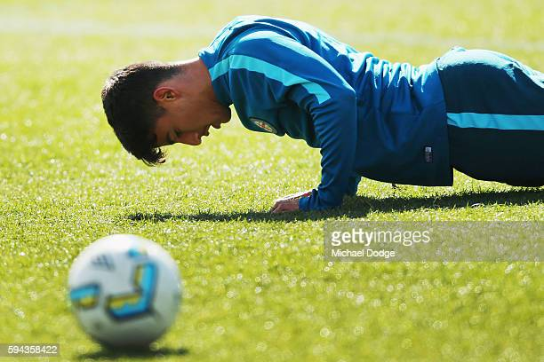 Daniel Arzani performs push ups during a Melbourne City FC ALeague training session ahead of their FFA Cup round of 16 match at La Trobe University...