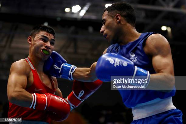 Daniel Asenov of Bulgaria and Galal Yafai of Great Britain or Team GB compete in the Boxing Men's flyweight 52kg SemiFinals bout during Day 8 of the...